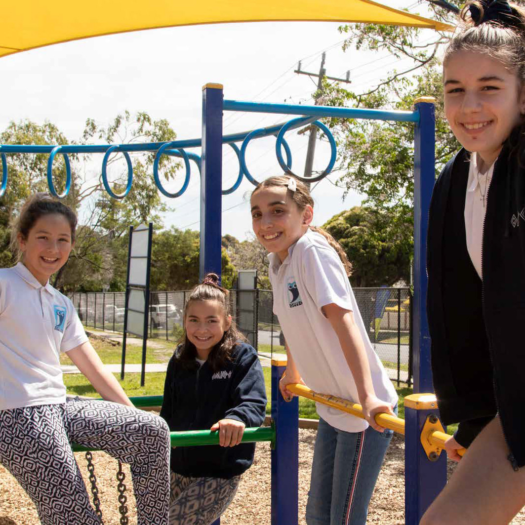 Omiros students on play equipment